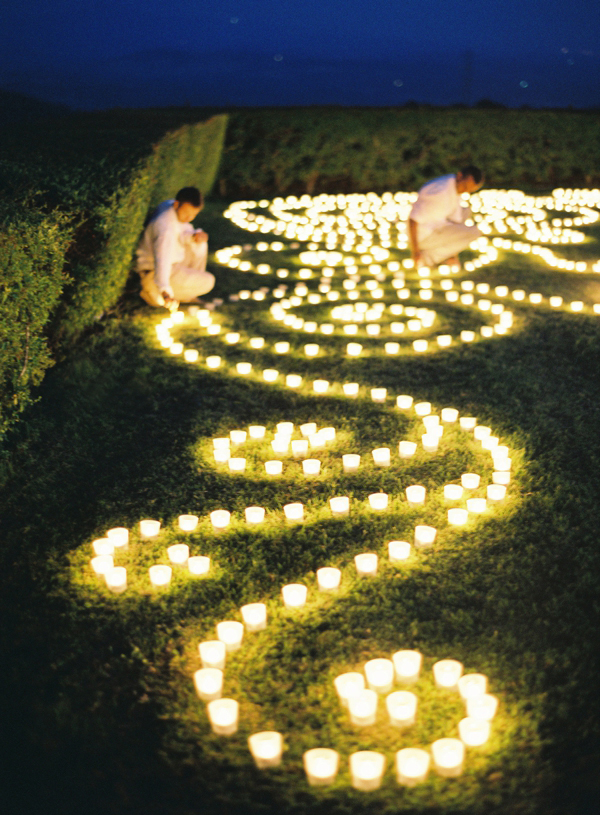 Wedding Lighting Ideas and Inspiration - Candles on the Grass Floor