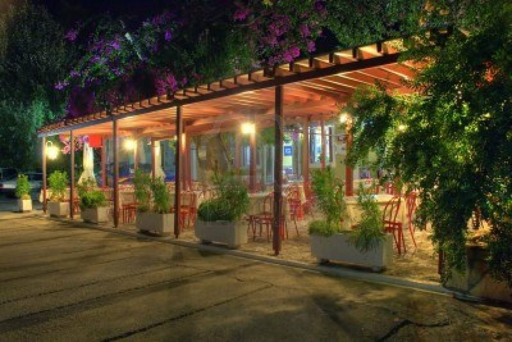 2902233-deserted-restaurant-highlighted-by-electrical-light-surrounded-by-plants-and-flowers-in-the-middle-o How Artificial Plant Lights Will Help Growing Your Plants?