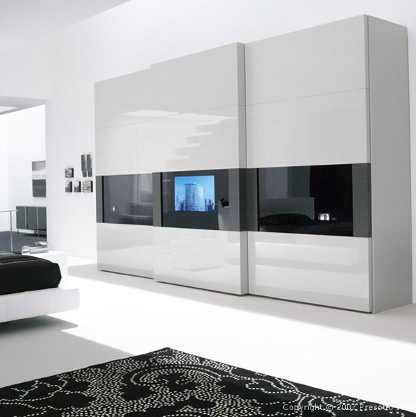 wardrobe-with-sliding-doors-and-built-in-TV How to Choose Contemporary Bedroom Furniture