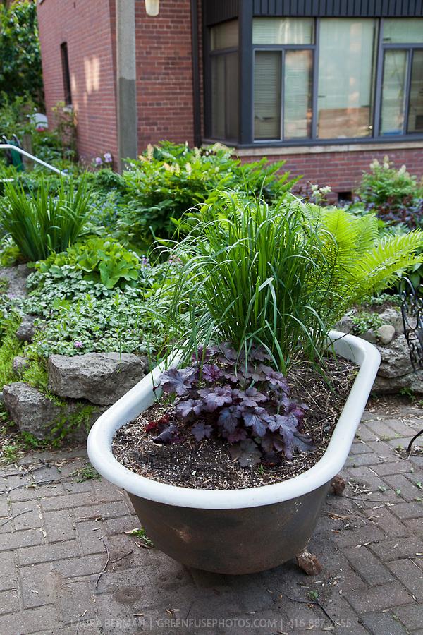 Bathtub-planter-L 10 Fascinating and Unique Ideas for Portable Gardens