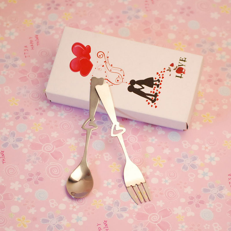 Silver-Spoon-and-Fork-Set-with-Heart-Design-for-Wedding-Gift-Purpose 20 unique wedding giveaways ideas