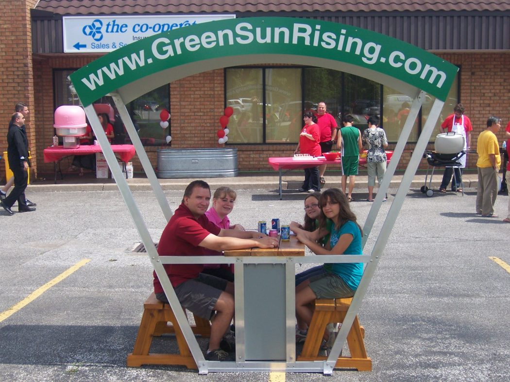 family-using-solar-bench Did You Hear About The Solar Bench (streetlight bench)?