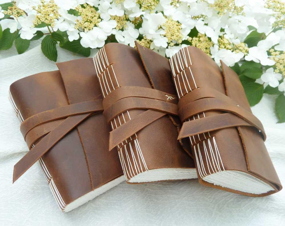 rad-wedding-gifts-for-groomsmen-best-man-leather-notebooks.original 20 unique wedding giveaways ideas