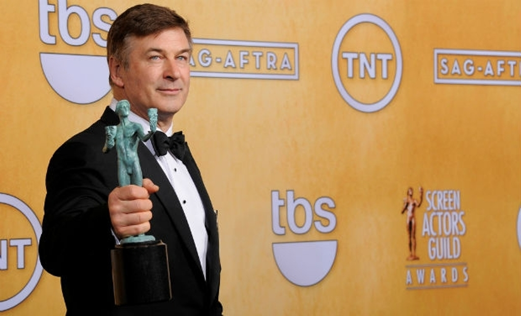 Alec Baldwin poses backstage with the award for outstanding male actor in a comedy series for '30 Rock' at the 19th Annual Screen Actors Guild Awards