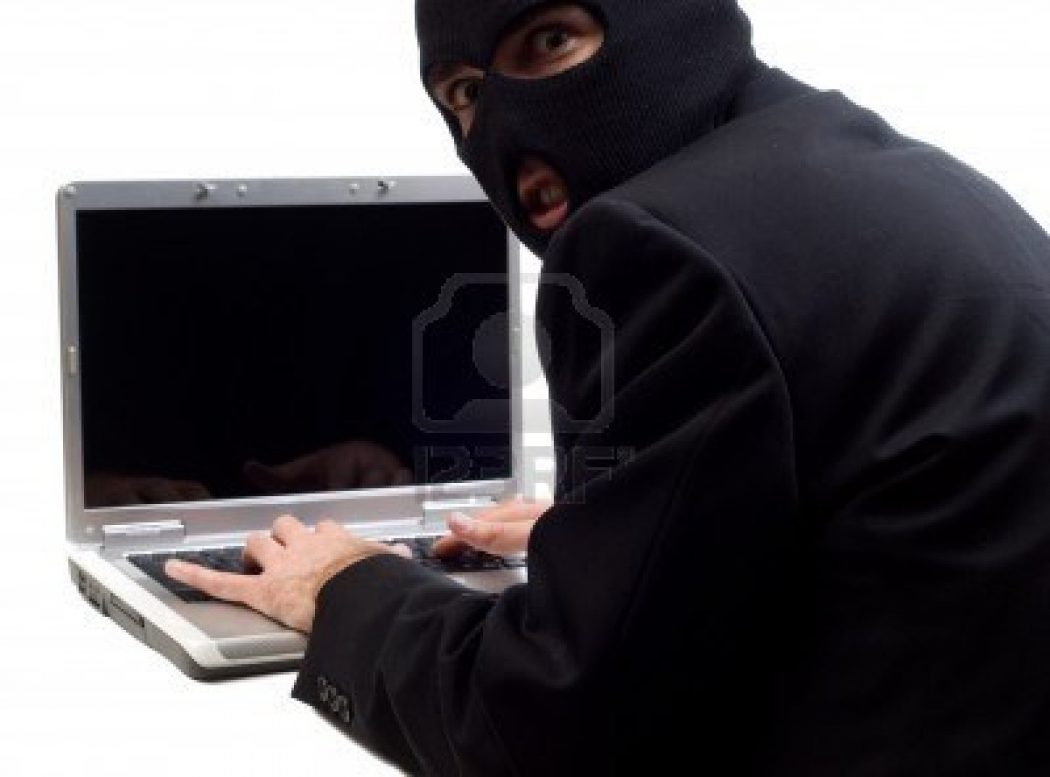 """hacker-is-using-a-laptop-computer-to-steal-information-isolated-against-a-white-background How to Remotely Monitor Your Computer and Record ALL Keystrokes Using """"Max keylogger""""?"""