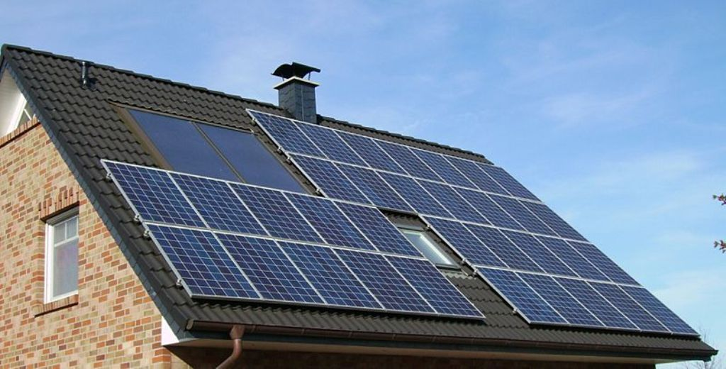 photovoltaic_panels_on_roof1 The Simplest Methods to Slash Your Power Bill By Earth4Energy