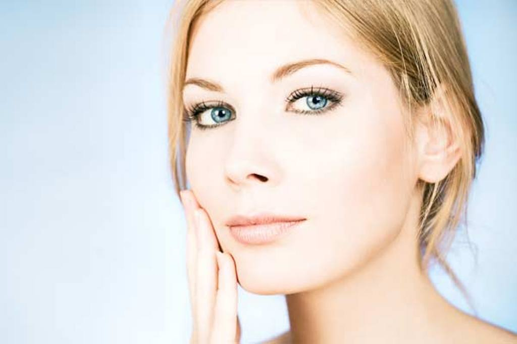 woman-with-glowing-skin Why Acne No More was my Solution for Clear Skin