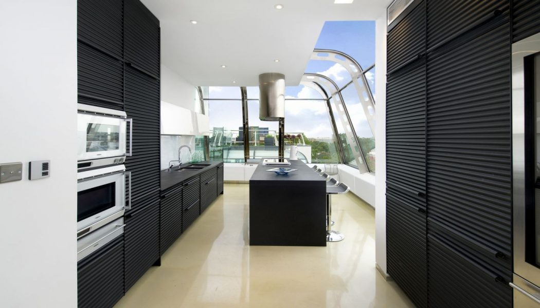 black-kitchen-cabinets-combined-with-white-wall-for-2013-design-guide Frugal And Stunning kitchen decoration ideas