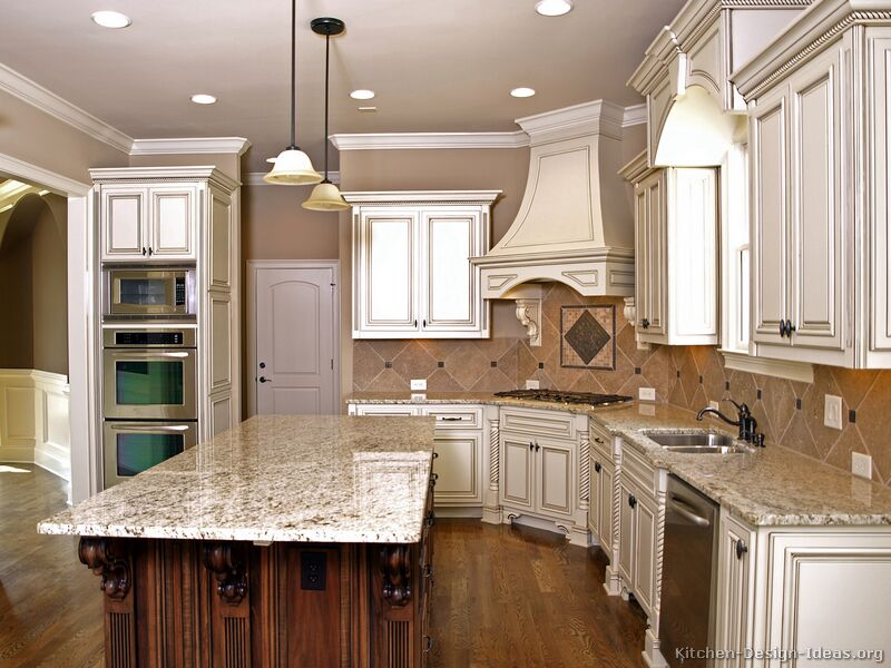 kitchen-cabinets-traditional-two-tone-antique-white-wood-hood-island-luxury Stunning And Contemporary Victorian Decorating Ideas
