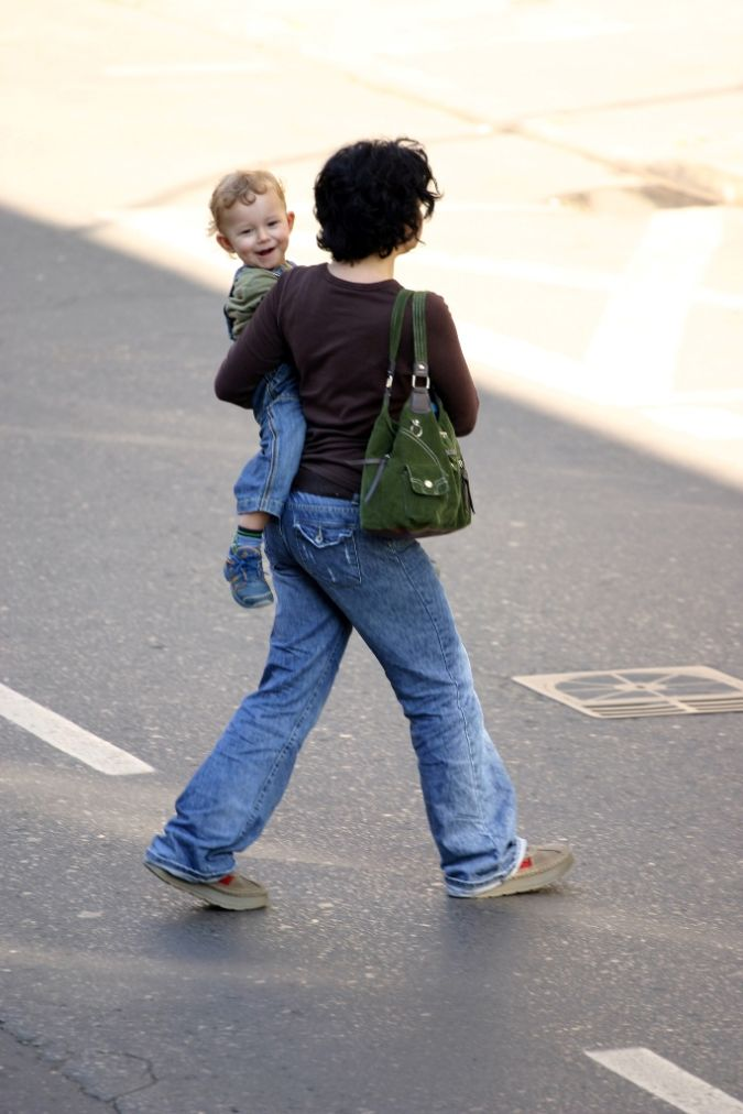 mother-carrying-child Do You Know How to Deal with Tantrums?