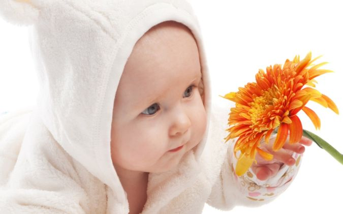 Baby-Picture-Touching-Yellow-Flower Top 20 Names for Your Baby Boy