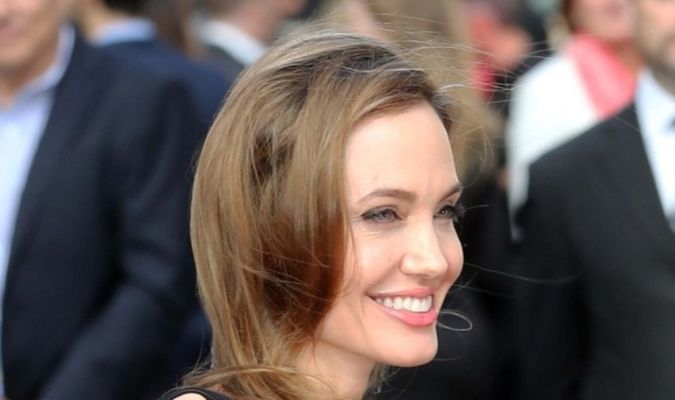 Brad_Pitt_Angelina_Jolie_arrive_world_premiere_B Angelina Jolie Catches the Eyes of Her Lovers and Cameras after Her First Appearance Since Mastectomy