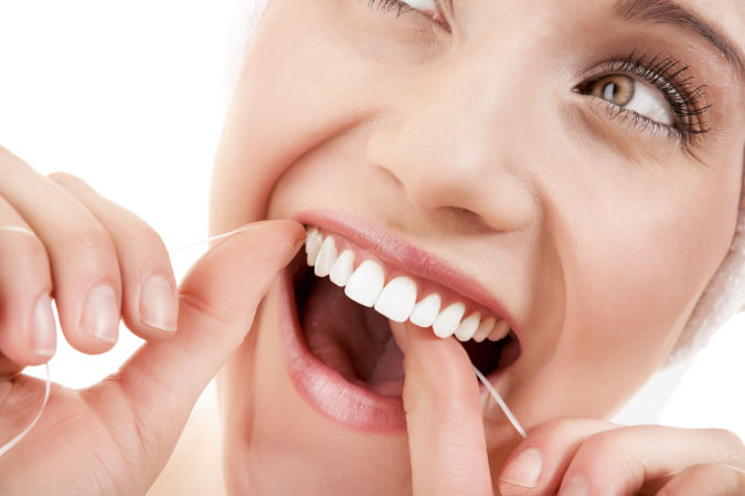 Daily-Floss-to-Whiter-Teeth Whitening Your Teeth At Home