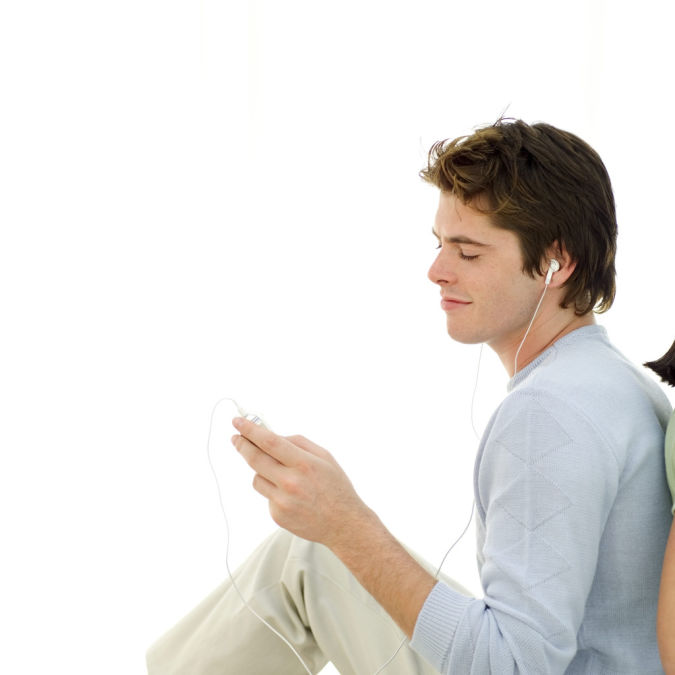 Man-sitting-listening-to-music-on-MP3-player How to Get Rid of Your Accent