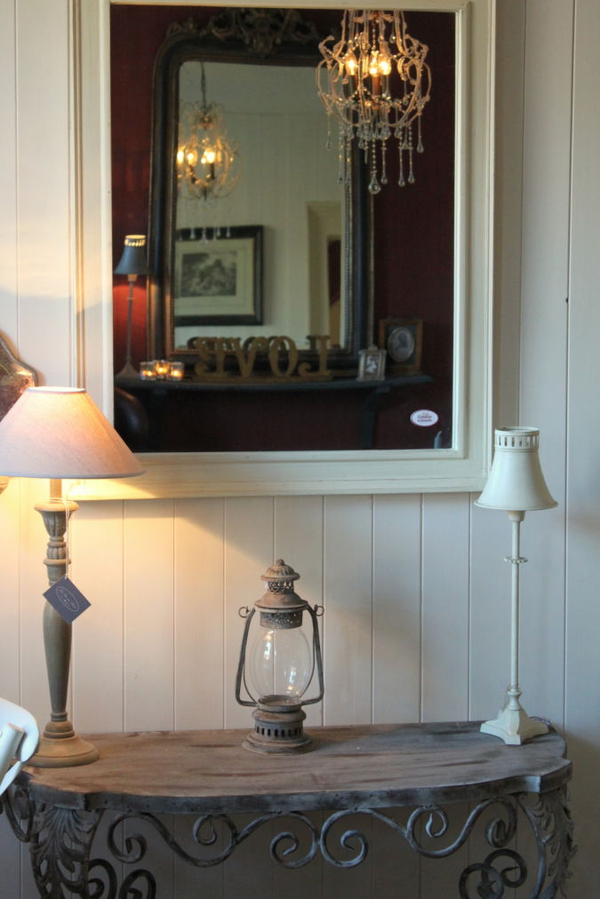 Mirror-with-reflection-of-chandelier Make a Big Difference In Your Home By Adding Mirrors