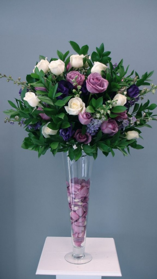 Tall-purples-with-ivory-rose-petals-in-vase 50 Fabulous and Breathtaking Wedding Centerpieces