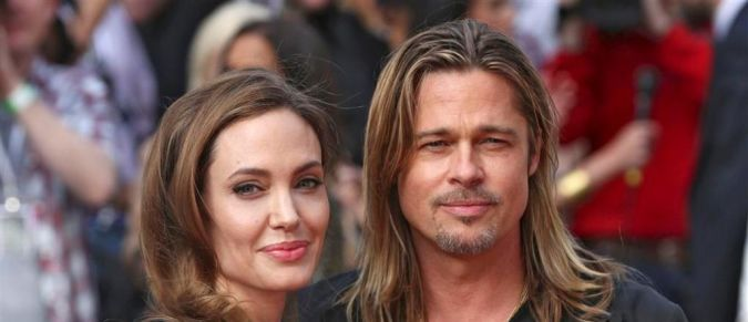 angelina_jolie_poses_with_her_husband_brad_pitt Angelina Jolie Catches the Eyes of Her Lovers and Cameras after Her First Appearance Since Mastectomy