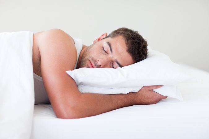 bigstock-Man-Sleeping-In-Bed 11 Tips on Mixing Antique and Modern Décor Styles