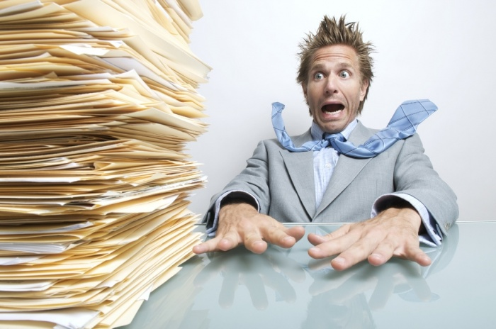 man-in-overload2 How to Get Your Boss to Lessen Your Workload