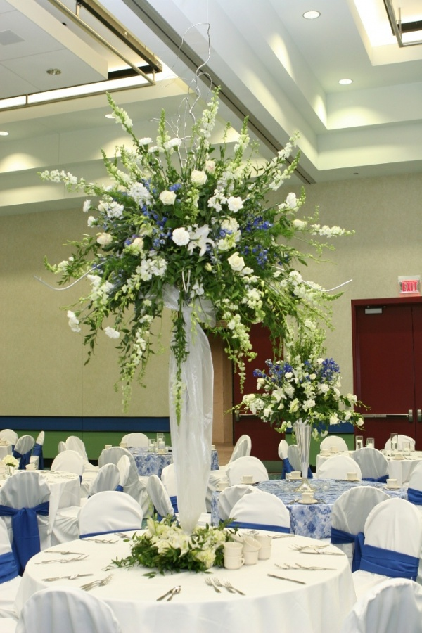 tall-centerpiece-by-llodys-florist-photo-by-photography-by-sara 50 Fabulous and Breathtaking Wedding Centerpieces