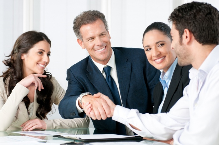 team-smiling-with-handshake How to Get Your Boss to Give You More Responsibility
