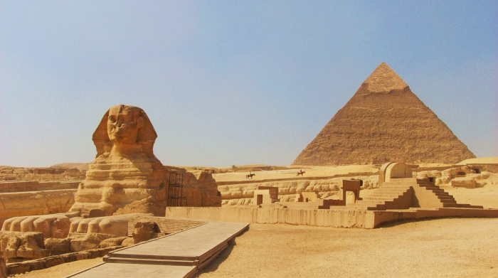 the-sphinx-at-gizacairo-in-egypt-with-the-pyramid-of-chephren-khafre-in-the-background Egyptian Pyramids Architecture