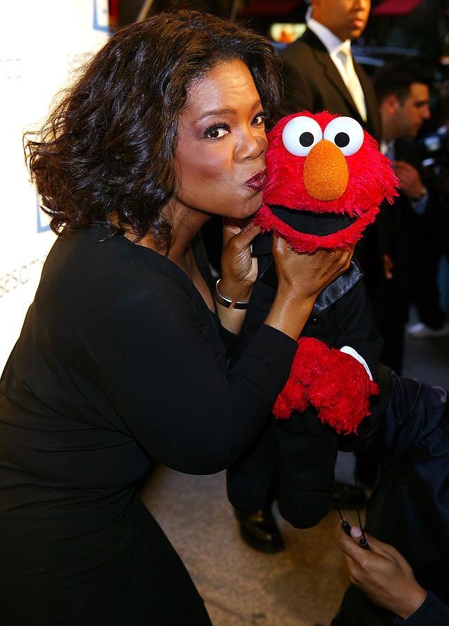 tv-host-oprah-winfrey-and-friend-elmo-everett The Beloved Oprah Winfrey