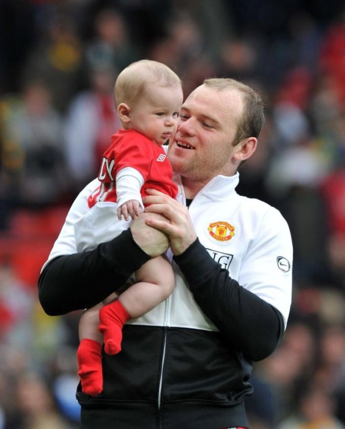 wayne-rooney-with-Child Top 10 Football Players