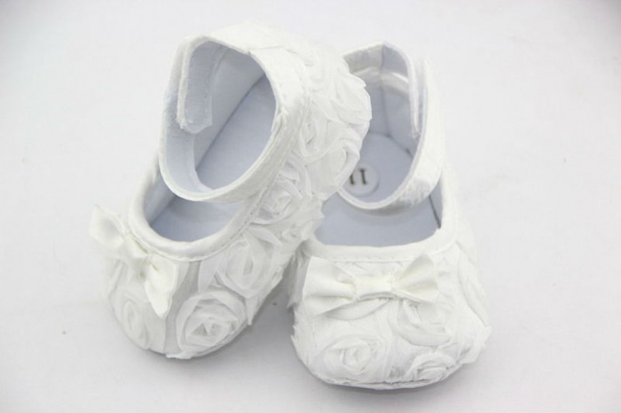white-shoes 5 Important Considerations to Make Before Buying Your Wedding Dress
