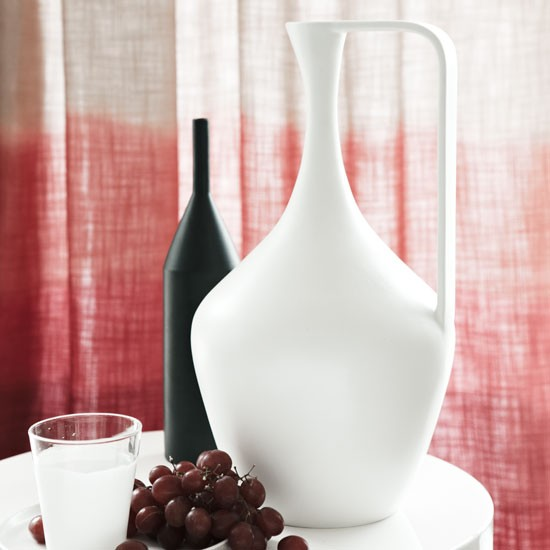 Pink-and-white-dip-dyed-curtain-behind-ceramic-vases 35 Designs Of Ceramic Vases For Your Home Decoration