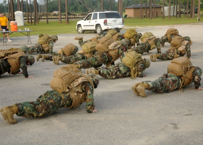 US_Navy-Seabees_perform_push-ups_in_gear_during_a_battalion_Readiness_Exercise_held_on_Naval_Construction_Battalion_Center_Gulfport What Are the Military Workouts?