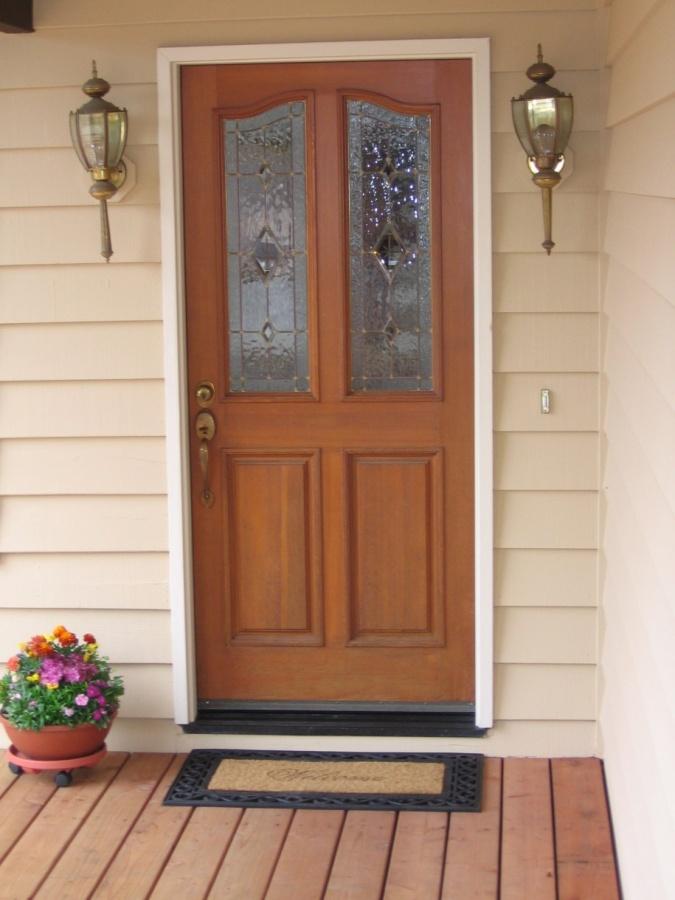 Wooden-Floor-Classic-Wall-Lamps-Cream-Wall-Front-Door-Designs-915x1220 23 Designs To Choose From When Deciding On A Front Door