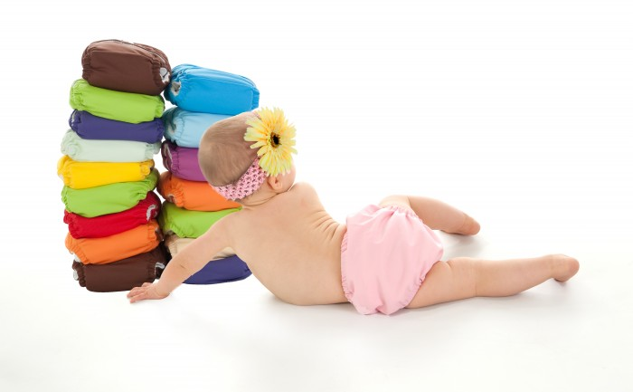 baby-girl-with-stack-of-diapers Proven Method for Quickly & Easily Potty Training in 3 Days