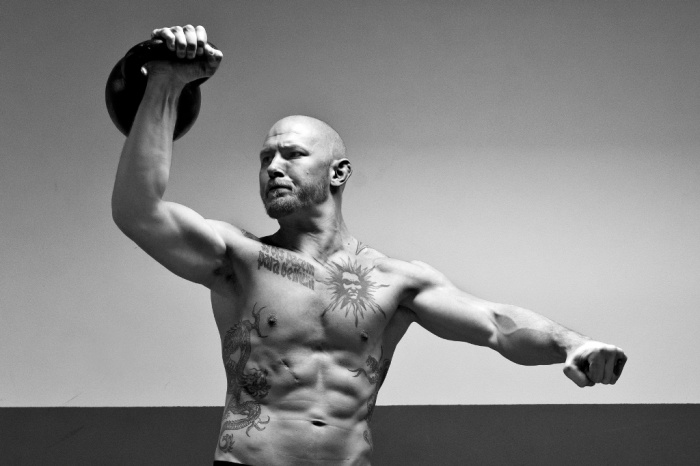 tommy-blom-kettlebell-press 10 MMA Workouts to Achieve Fitness