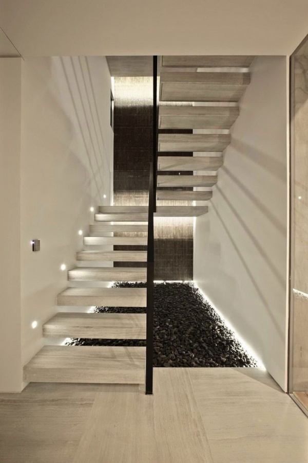 White-Wooden-Stairs-With-Black-Fences-Placed-With-Stone-Under-It Turn Your Old Staircase into a Decorative Piece