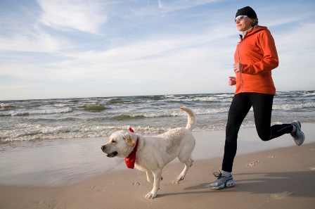 Woman-Running-with-Dog Help Your Pet Animal To Lose Weight