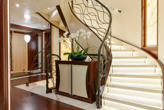 a-grand-staircase-with-a-stylized-modern-banister-beckons-guests-toward-the-upper-levels-of-the-ship Make Your Home Look Like a Palace