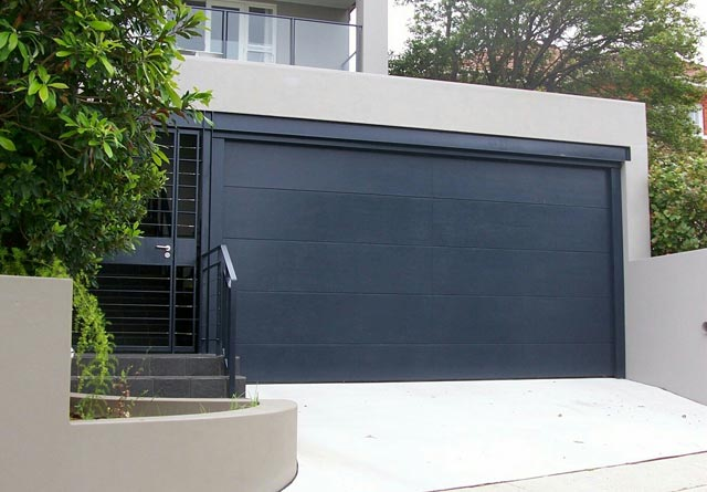Modern ideas and designs for garage doors pouted online for Modern house garage doors