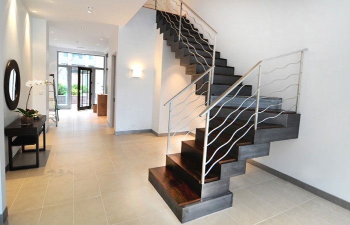 custom-built-staircase-modern-design-metal-railing-downtown-chicago Decorate Your Staircase Using These Amazing Railings