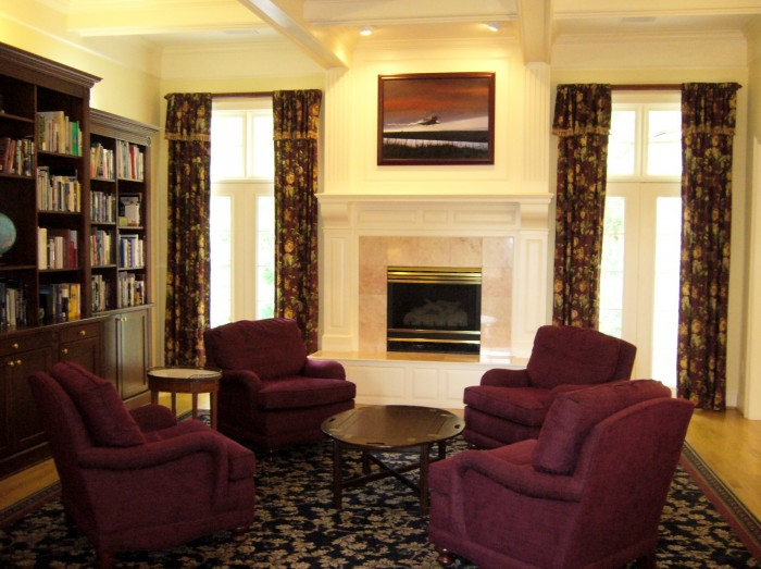 living-room-burgundy-chairs-navy-area-rug-floral-curtains-draperies-bookcase 8 Tips On Choosing A Carpet For Your Living Room