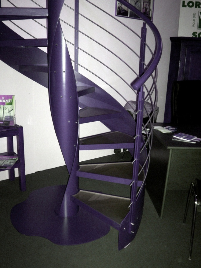 modern-staircase-design-with-a-circular-shape-made-of-iron-colored-purple-with-base-and-railing-touch-chrome-banisters-730x973 Turn Your Old Staircase into a Decorative Piece