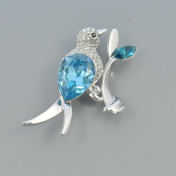 Cute_big_blue_crystal_and_clear_rhinestone_bird_animal_brooch_BT4378_ 11 Tips on Mixing Antique and Modern Décor Styles
