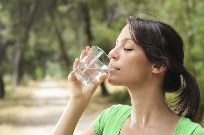 WomanDrinkingWater 10 Advantages Of Drinking Water Which Will Help You To Live A Healthy Life