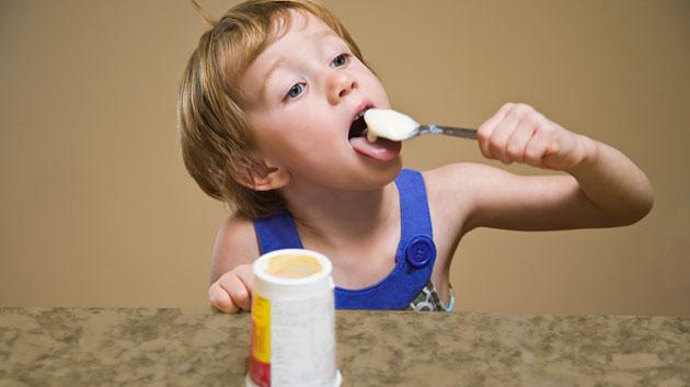 kid_eating_yogurt The Health Benefits Which Make Yogurt A Great Food For Your Kids