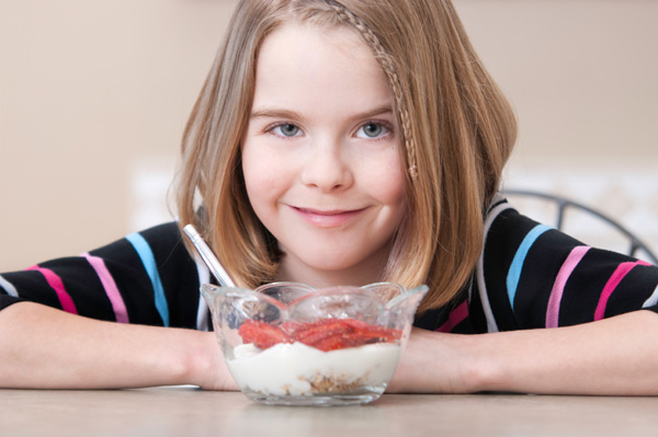 tween-girl-eating-yogurt The Health Benefits Which Make Yogurt A Great Food For Your Kids
