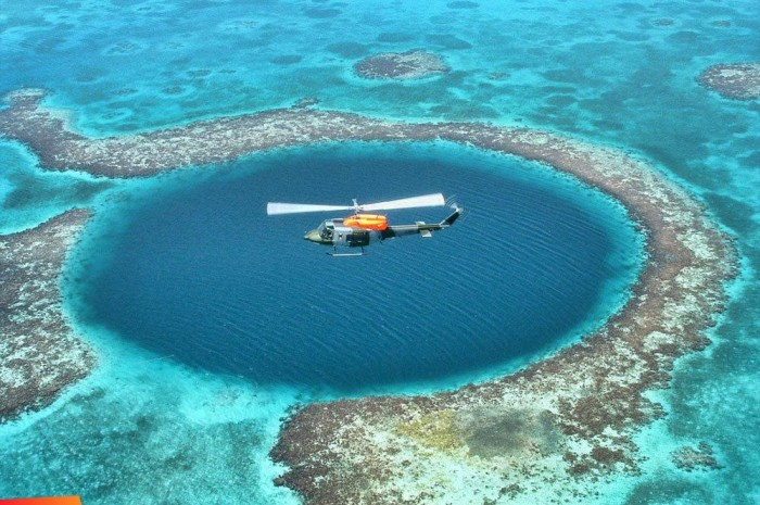 Belize-BLUE-HOLE-Helicopter-Portofino Weird Blue Holes That Are Magnets for Divers Around the World