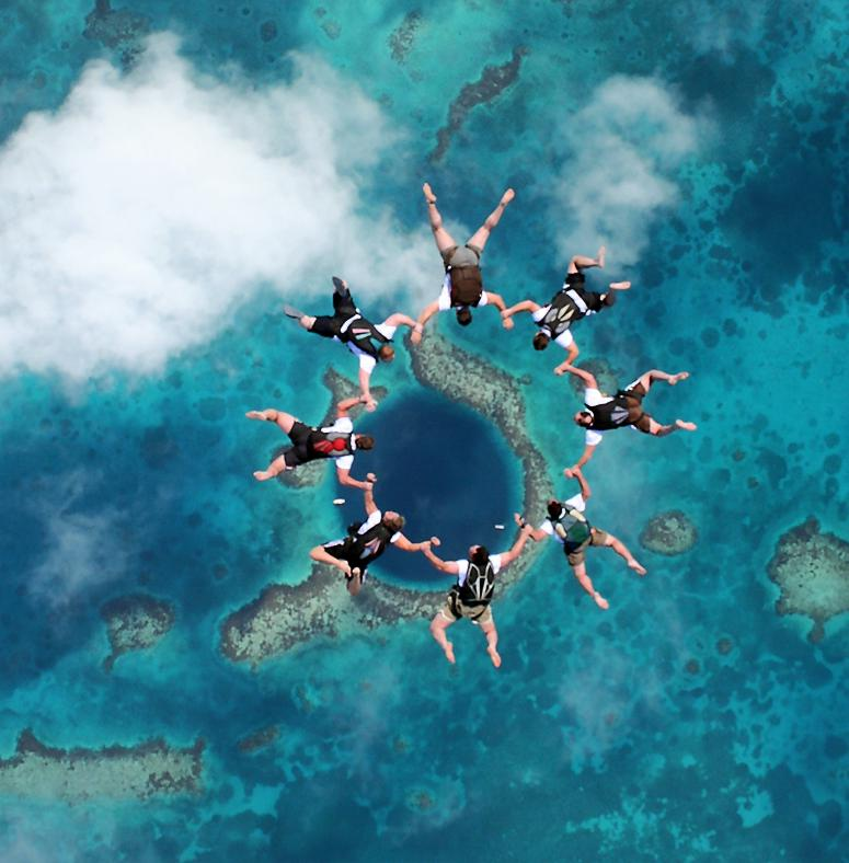 Fly-In-The-Great-Blue-Hole-Belize-picture Weird Blue Holes That Are Magnets for Divers Around the World