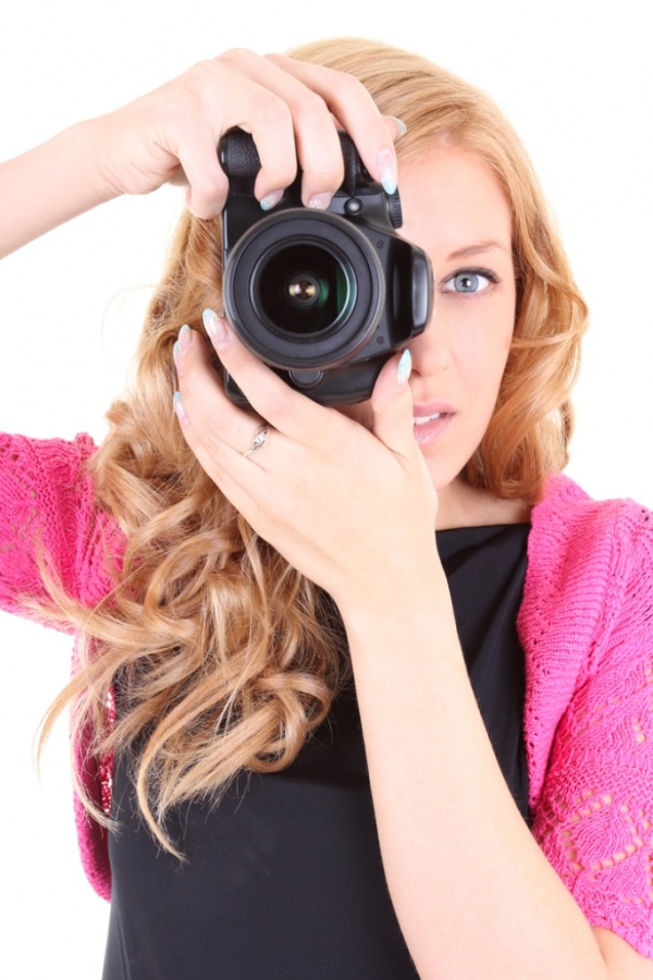 Woman-with-digital-camera- Easy to Follow Tricks & Secrets for Taking Better Digital Photographs