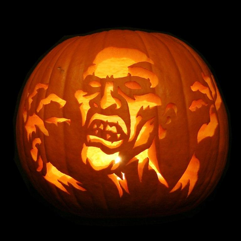 exterior-interior-amazing-halloween-carved-pumpkin-showing-a-scary-man-cool-halloween-pumpkin-design-ideas Top 60 Creative Pumpkin Carving Ideas for a Happy Halloween