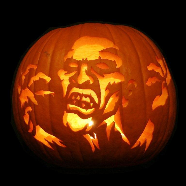 exterior-interior-amazing-halloween-carved-pumpkin-showing-a-scary-man-cool-halloween-pumpkin-design-ideas Top 60 Creative Pumpkin Carving Ideas for a Happy Halloween